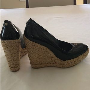 Black patten leather with jute covered wedge heel.